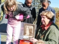 Chairperson Carol Griffin explaining the time capsule to the children