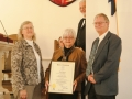 Robert Loomis and Judy Holcomb receiving presentation of Rep. Fahr