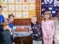 children with church 200th cake