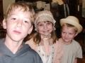 three children at the fellowship dinner