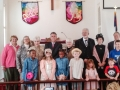 Officials and children posed for the 200th Sunday picture