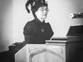 JoAnne Jones in Victorian garb at the keyboard