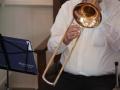 Pastor Jones playing trombone