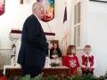 The children bring the manger scene figures forward