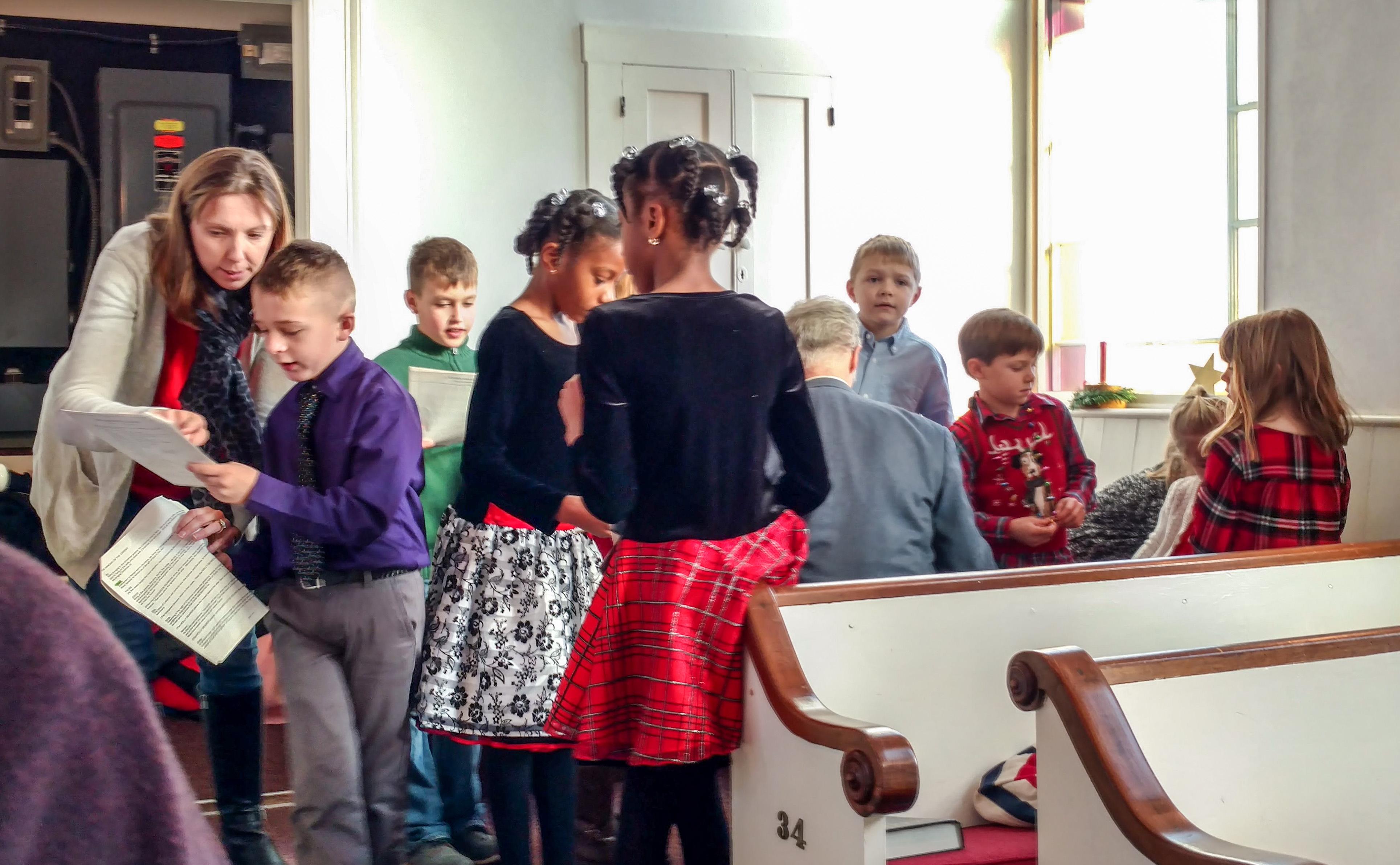 Children gather in the corner to organize