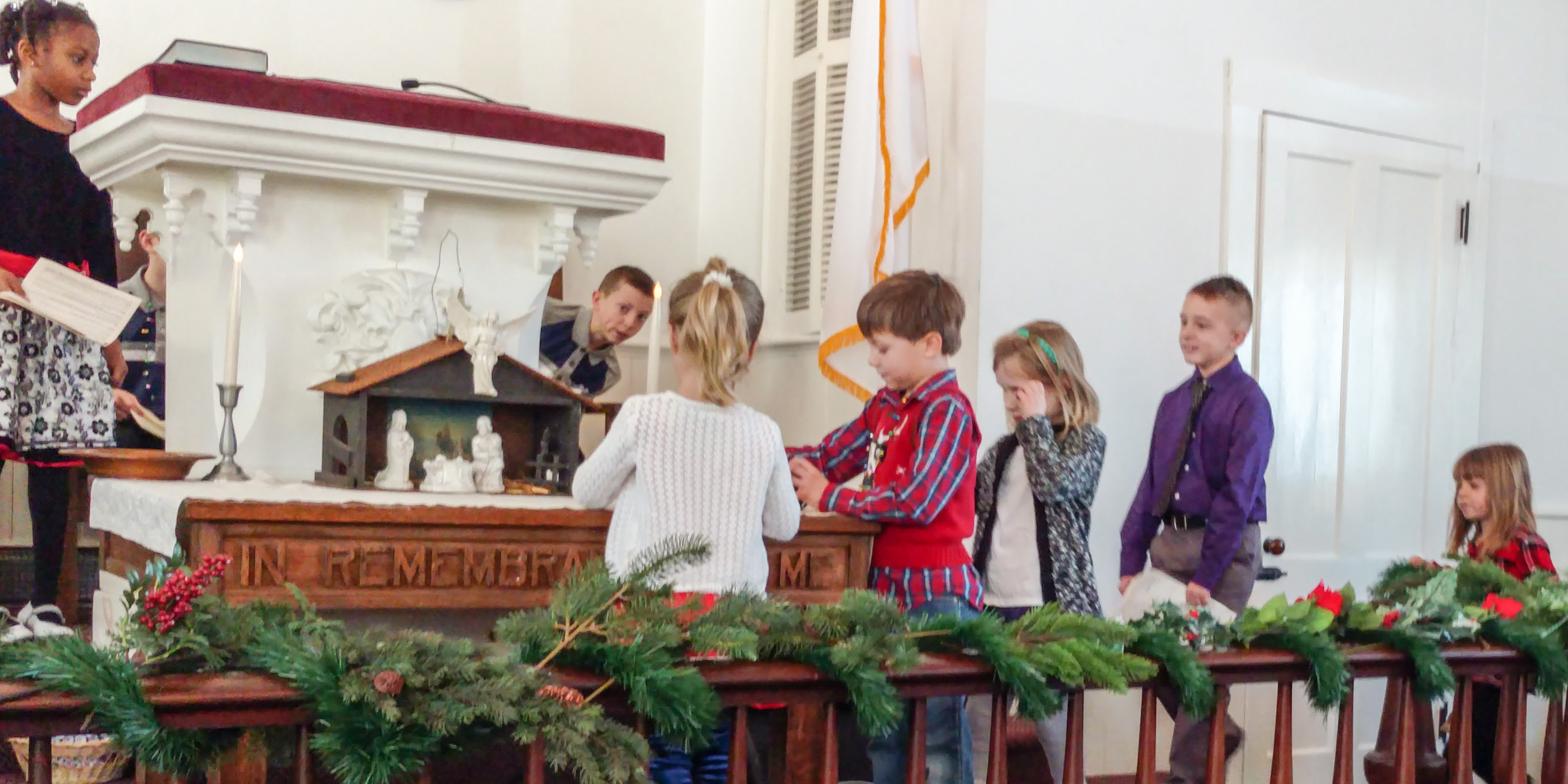 Stella and Parker placing itmes on the altar table