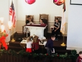 Stella and Camryn placing itmes on the altar table