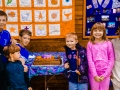The next generation of Copper Hill folks stand up with the 200th Anniversary cake