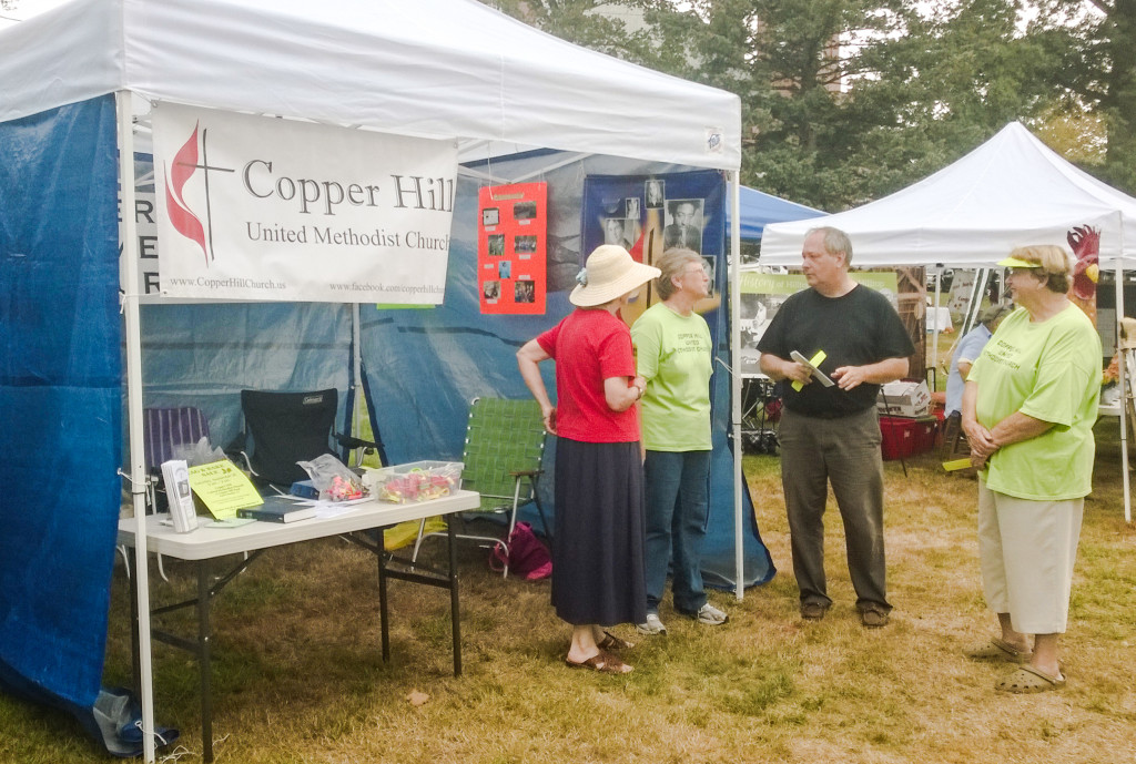 An informal chat by our booth on Saturday at Suffield on the Green
