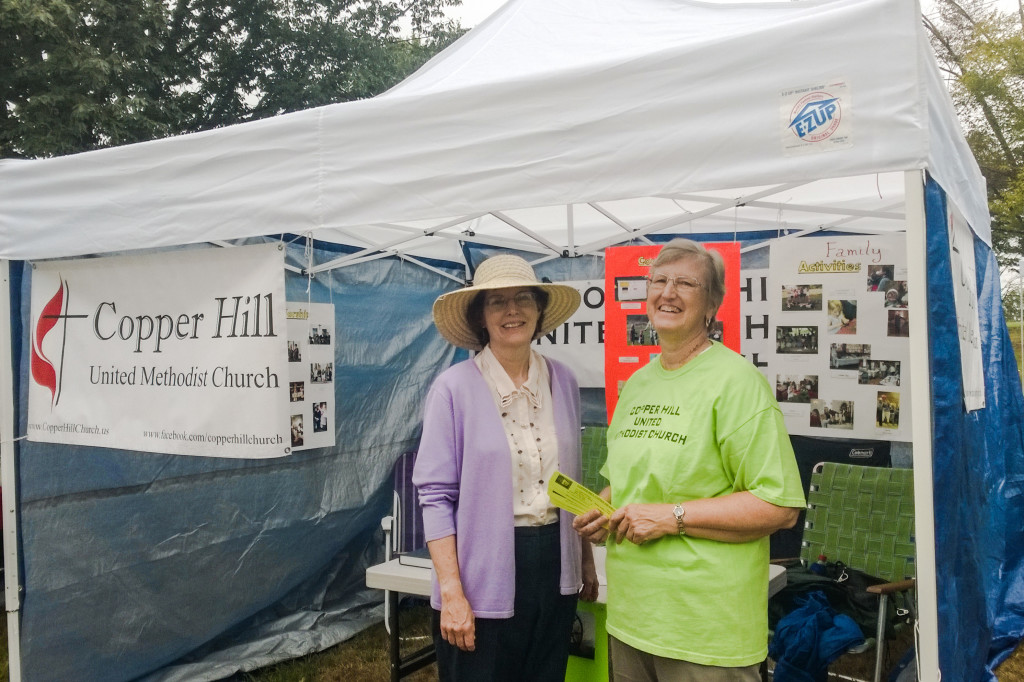 Volunteers judy Holcomb and JoAnne Jones in front of our booth at Suffield on the Green on Sunday