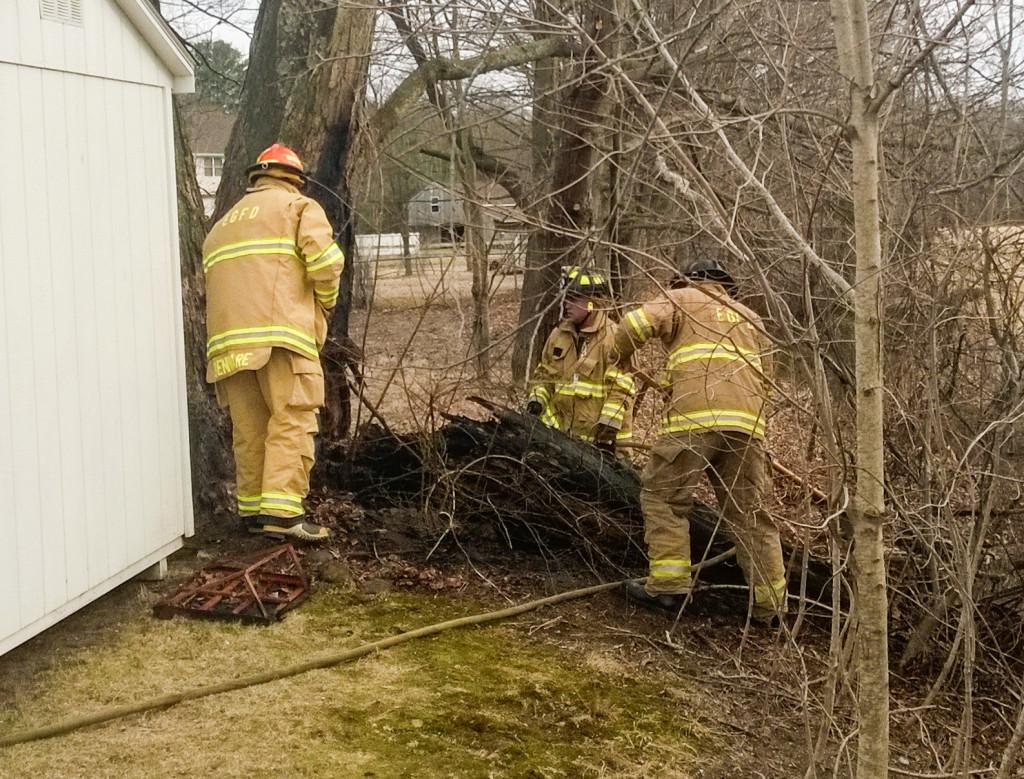 East Granby firemen extinguish brush fire